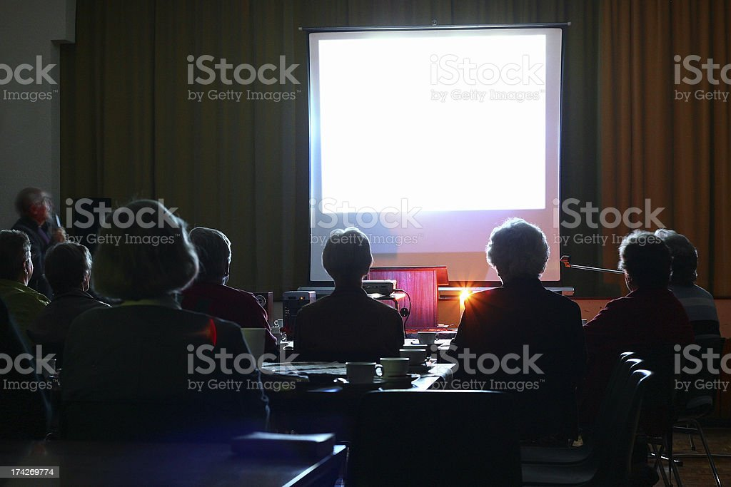 People looking at an evening presentation stock photo