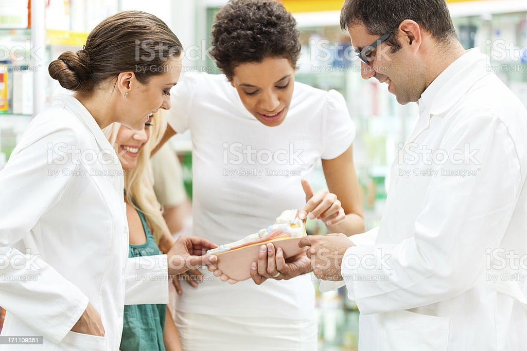 People looking at anatomical model of human foot royalty-free stock photo