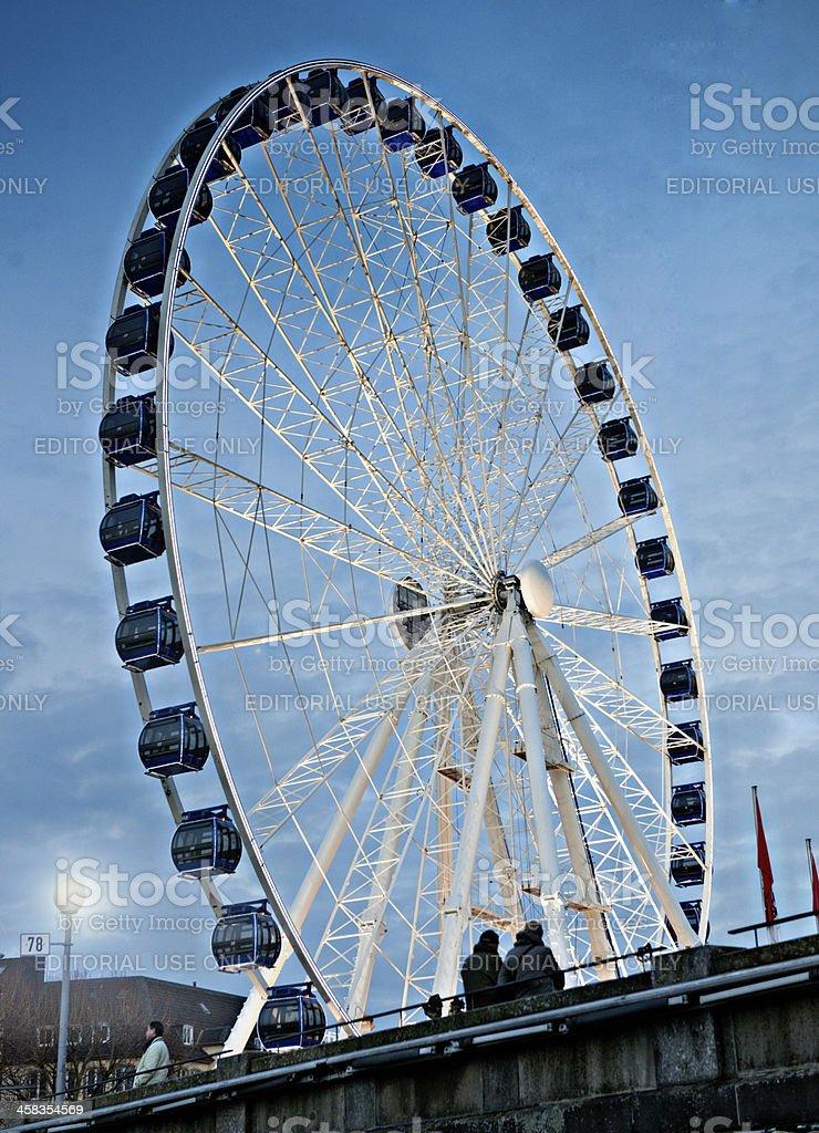 people looking at ferris wheel in Dusseldorf Germany stock photo