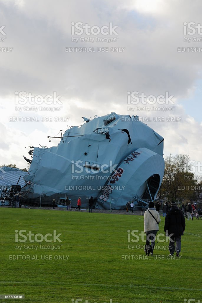 People looking at gas tower laying down after explosion. royalty-free stock photo