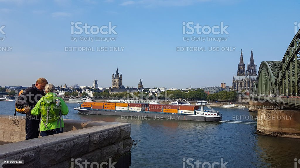 people looking at the Cologne Cathedral and river Rhine stock photo