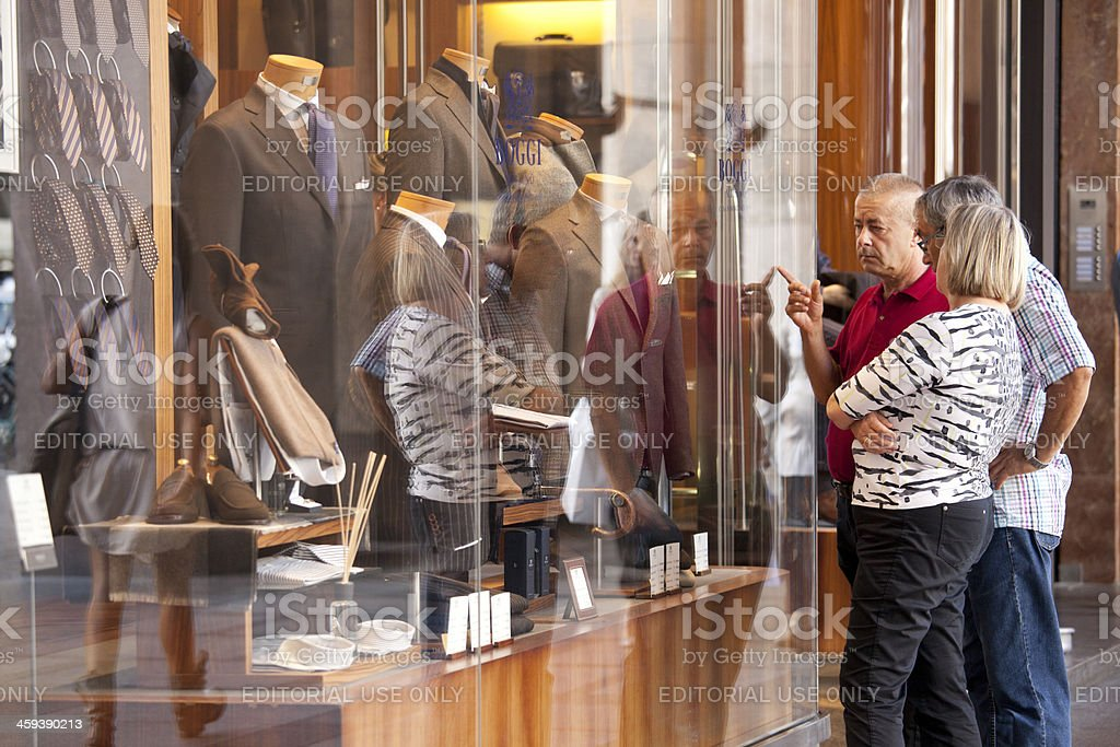 People looking at window display stock photo