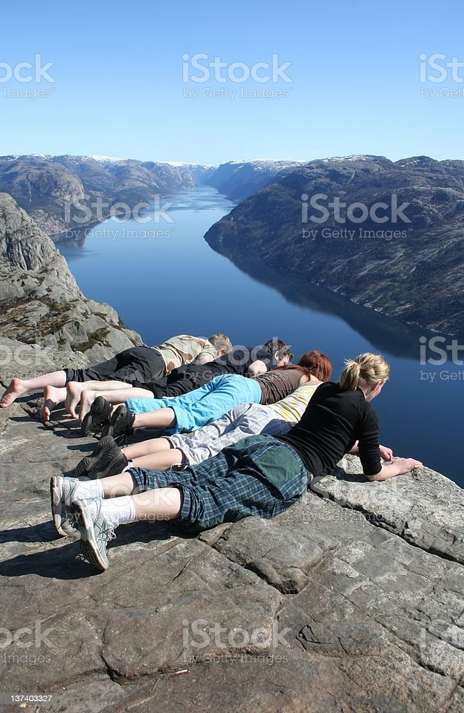 People looking down a cliff at pulpit rock royalty-free stock photo