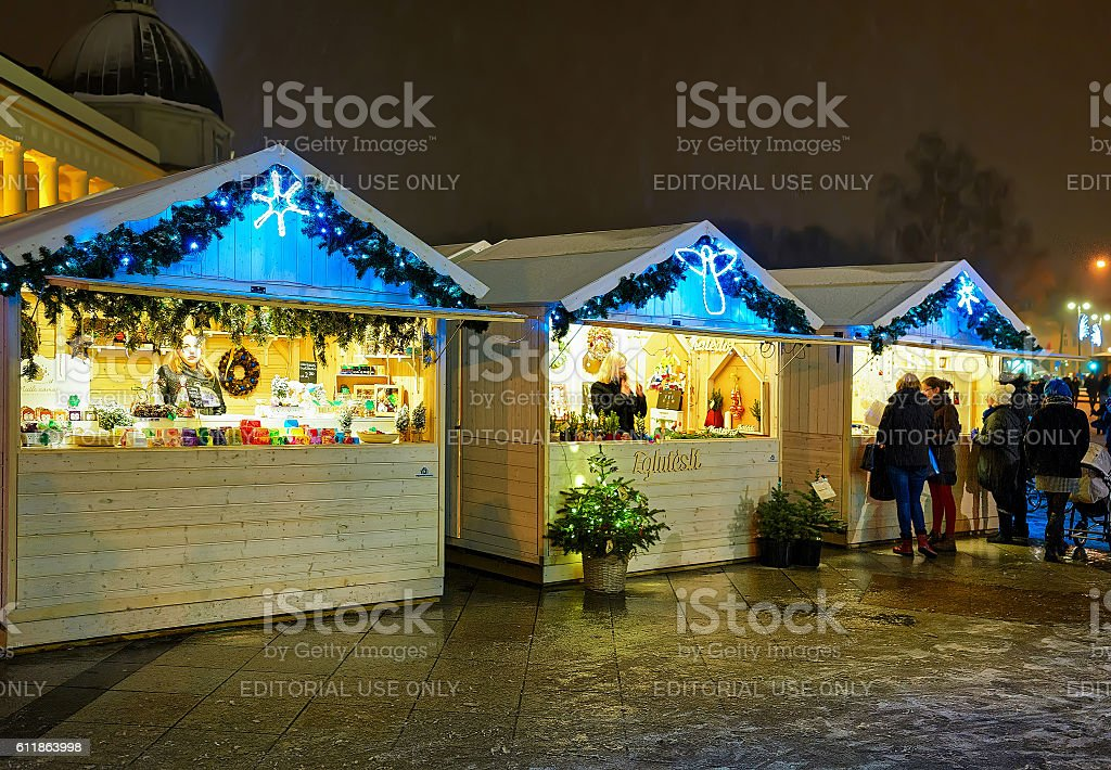 People looking for festive goods at the Vilnius Christmas Market stock photo