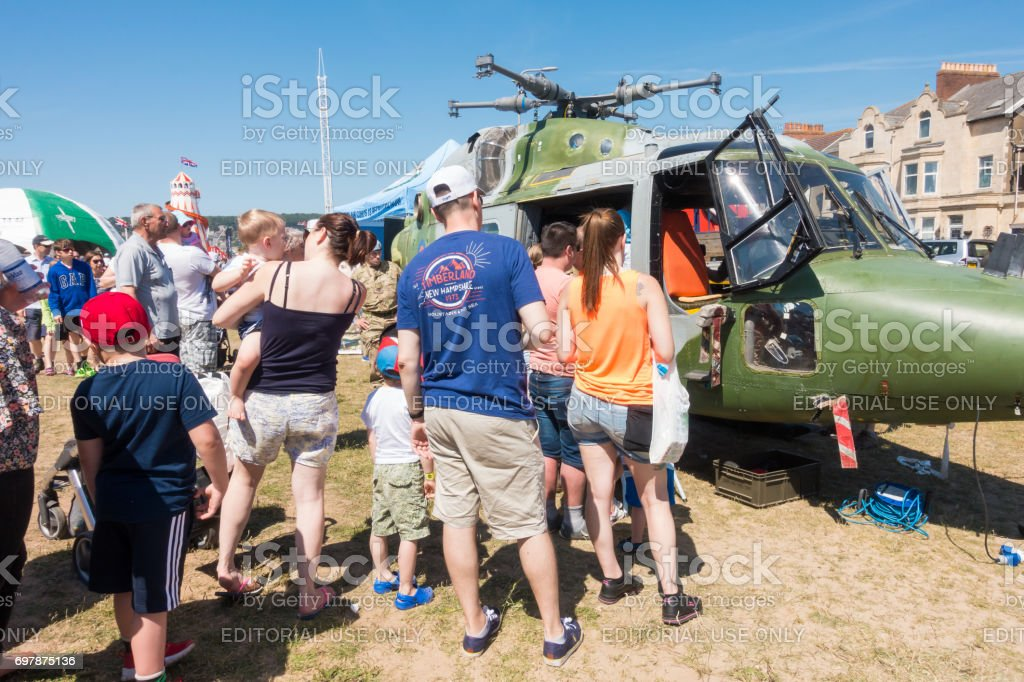 People looking inside a helicopter stock photo