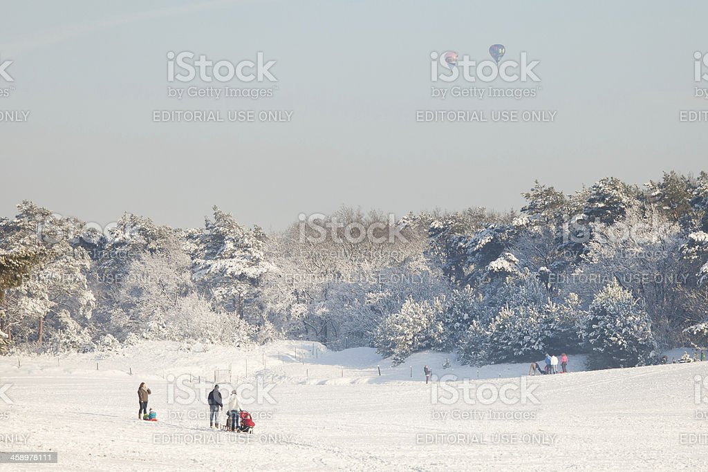People looking up at hot air balloons in winter royalty-free stock photo