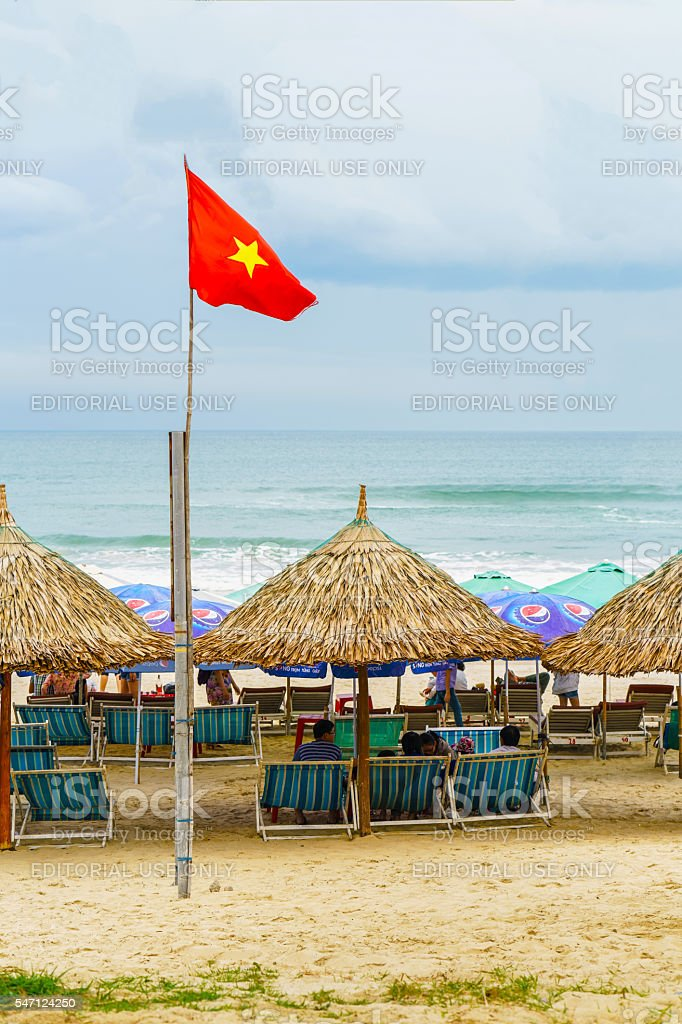 People lying on sunbeds in China Beach in Danang stock photo