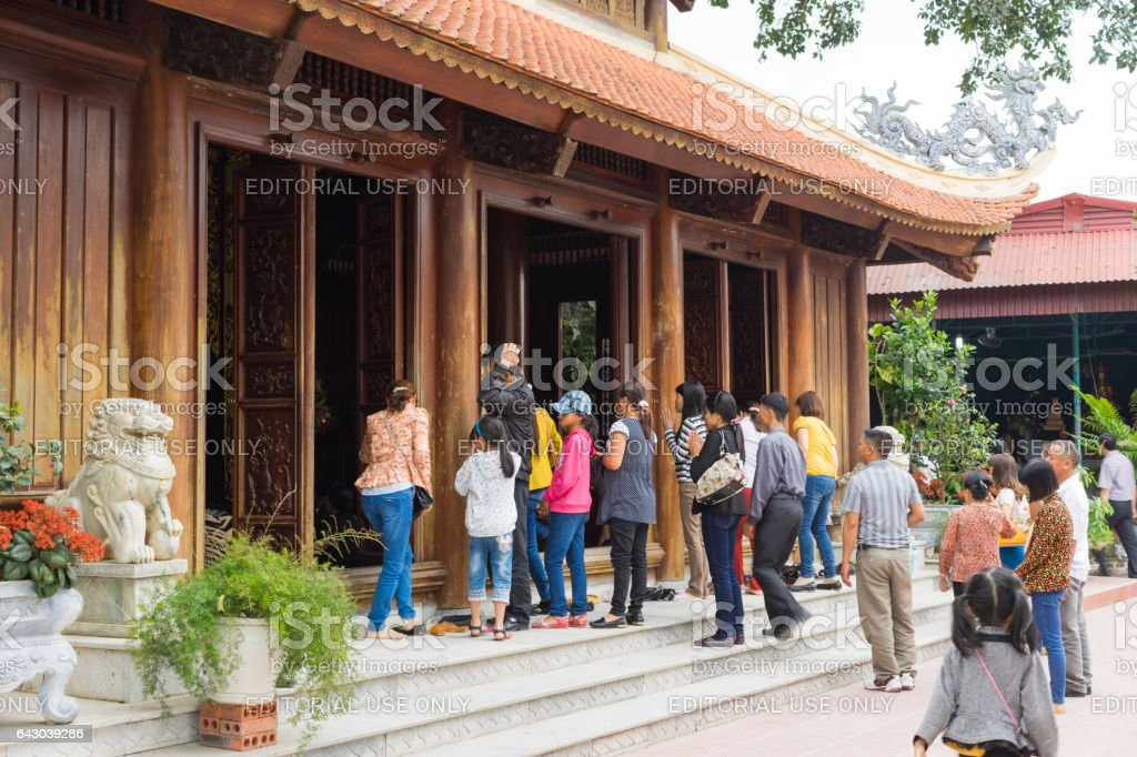 Quang Ninh, Vietnam - Mar 22, 2015: People make ceremonial offerings at Cai Bau pagoda. Giac Tam Meditation Monastery, also known as Cai Bau Pagoda, nestles on a 20-hectare plot in Van Don District stock photo
