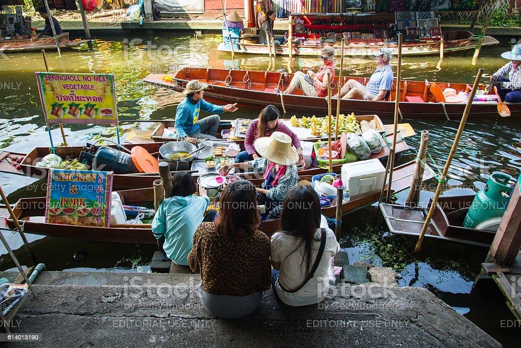 people makes noodle soup thai food at Damnoen Saduak floating stock photo