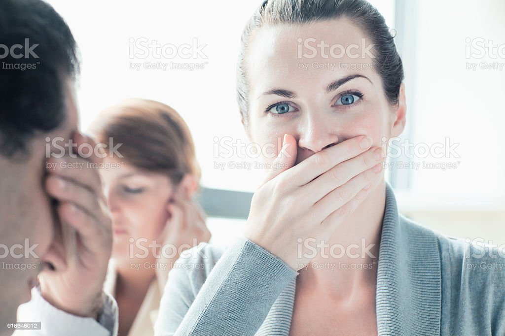 People making hear, see, speak no evil gesture stock photo