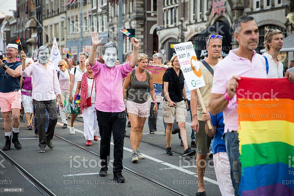People marching at Pride Walk Pink Saturday GayEuro Pride stock photo