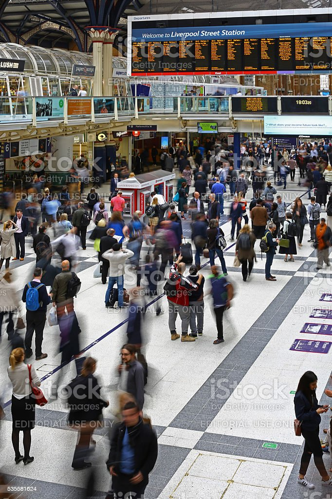 People moving in Liverpool street station, London stock photo