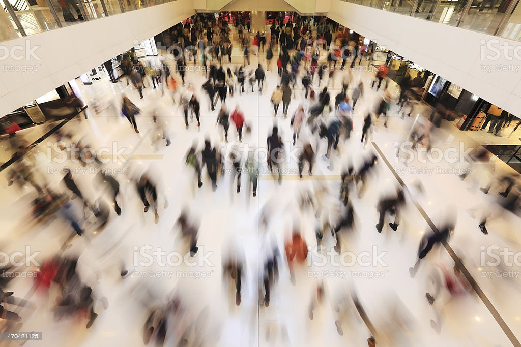 People moving quickly in a crowded area. stock photo