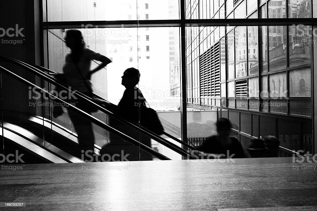 People Moving Up on Escalator, NYC. Black And White. royalty-free stock photo
