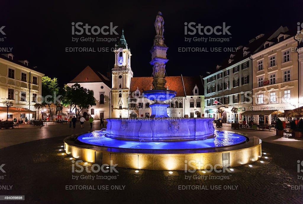 people near Roland Fountain Bratislava in night stock photo