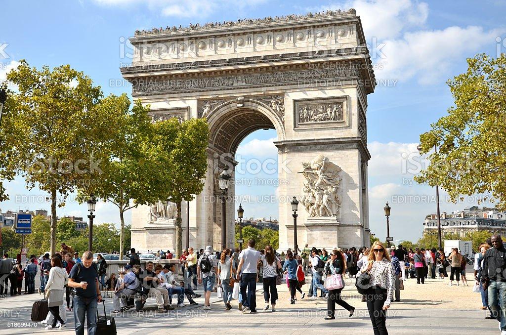 People near the famous monument 'The Arc de Triomphe' stock photo