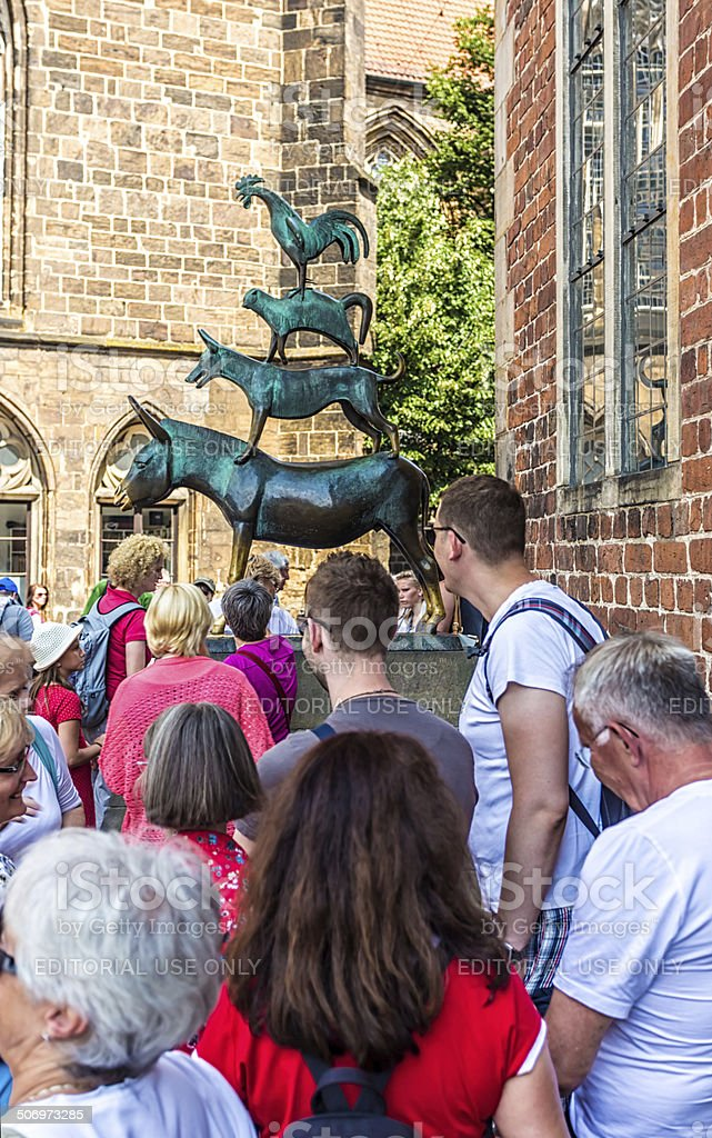 People near the statue of the town musicians in Bremen stock photo