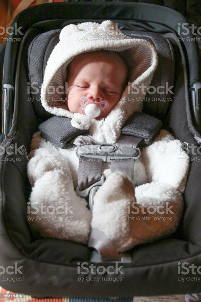 People: Newborn in a carseat stock photo
