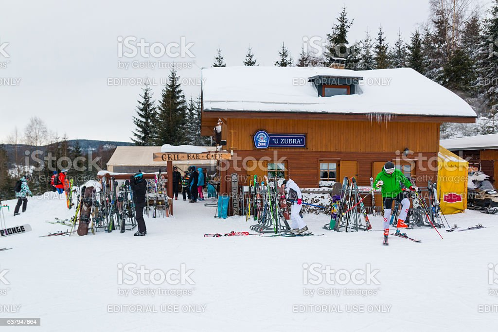 People next to wooden cafe in mountain Krkonose stock photo