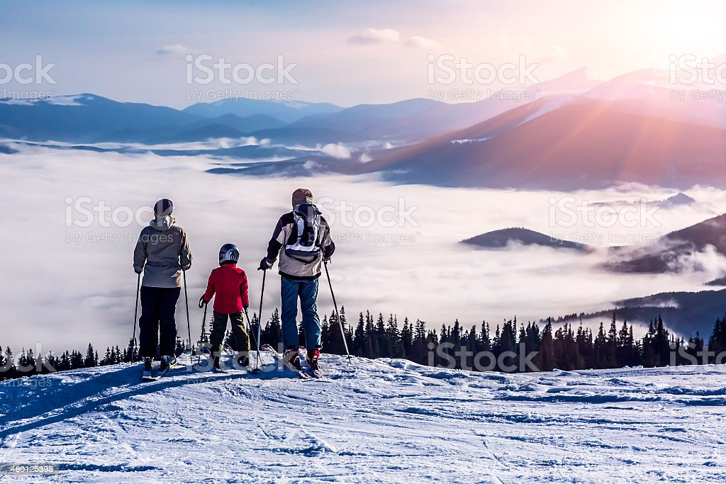 People observing mountain scenery stock photo