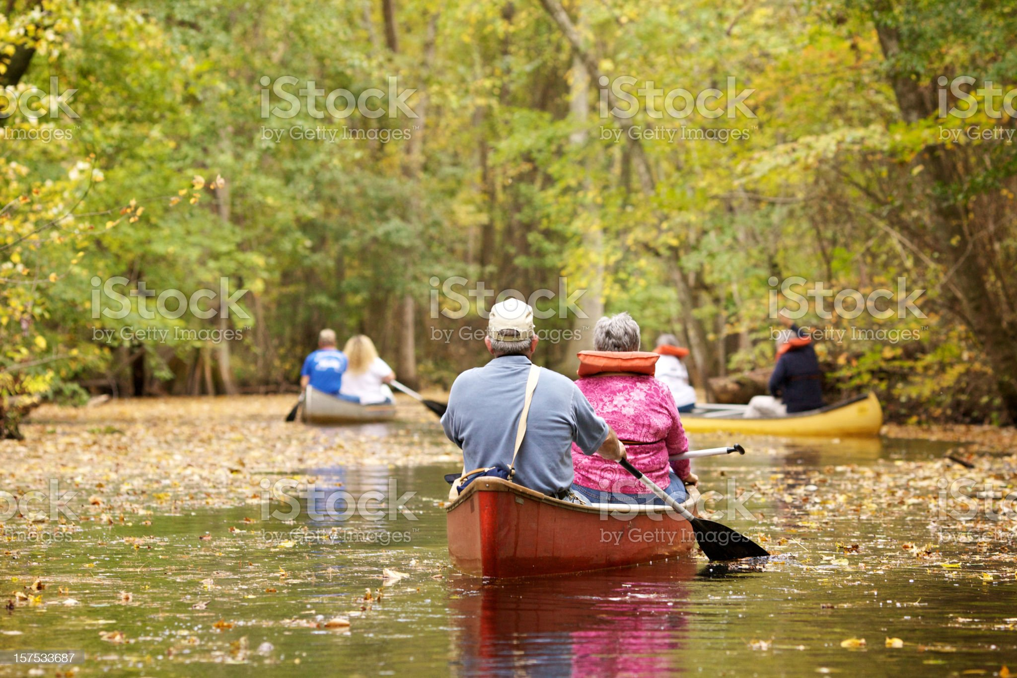people of all ages canoeing royalty-free stock photo