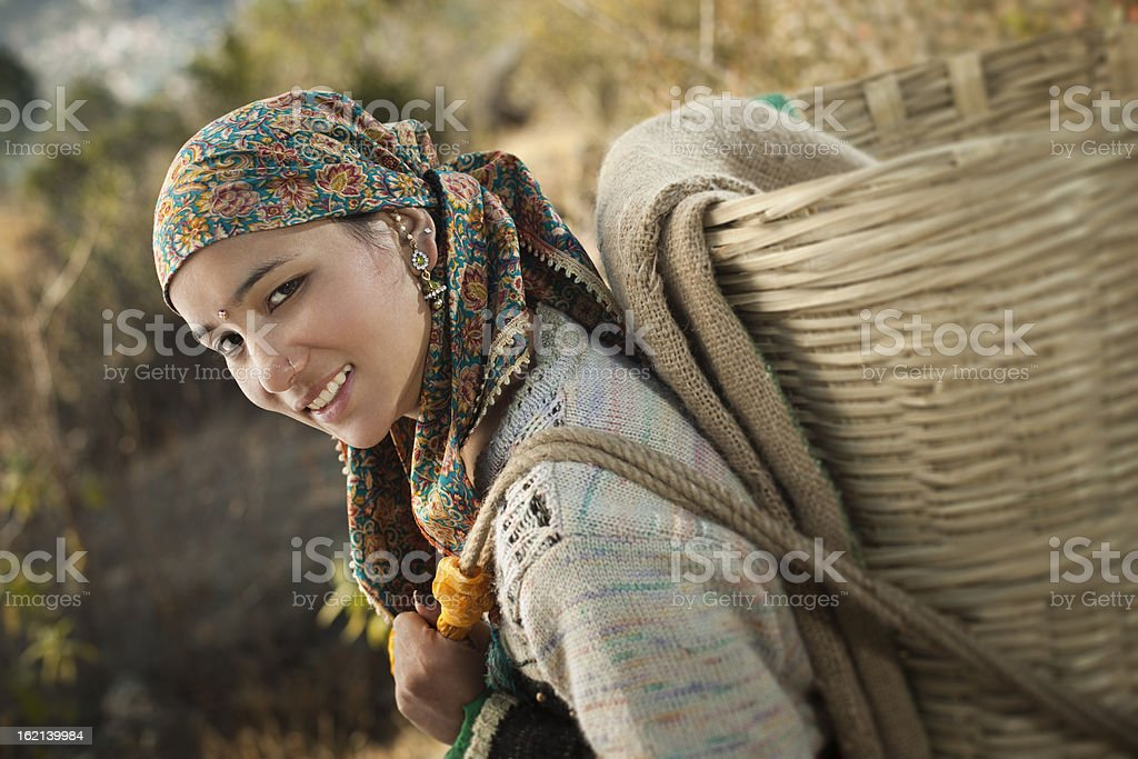 People of Himachal Pradesh: beautiful young woman carrying basket royalty-free stock photo