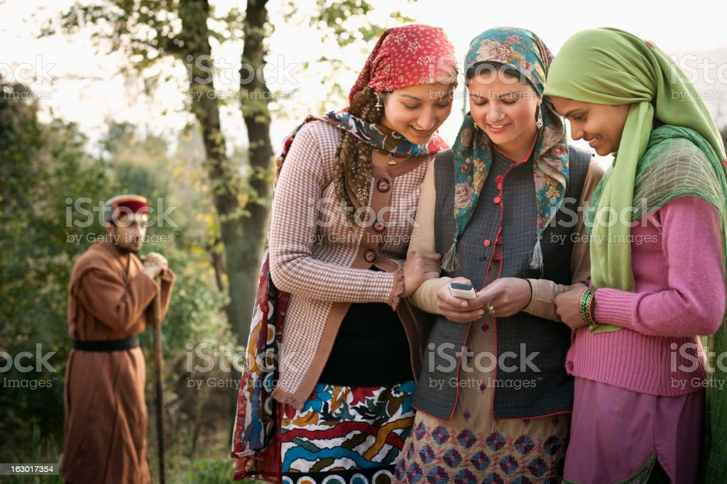 People of Himachal Pradesh: Beautiful young women using mobile p stock photo