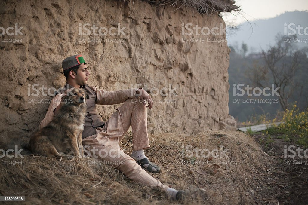 People of Himachal Pradesh: Confident young man using mobile pho royalty-free stock photo