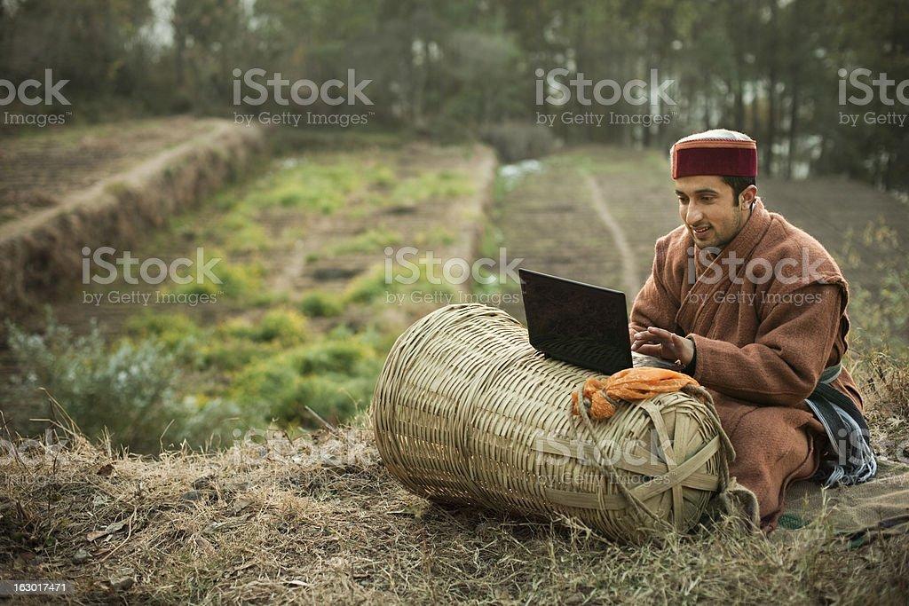 People of Himachal Pradesh: Young farmer using laptop stock photo