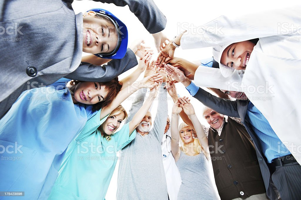 People of various occupations putting their hands together. royalty-free stock photo