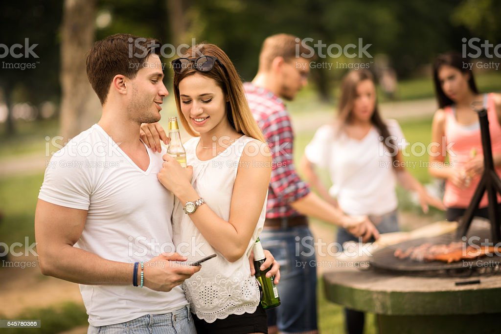 People on a barbecue picnic stock photo