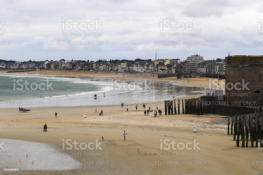 People on a beach in Saint-Malo stock photo
