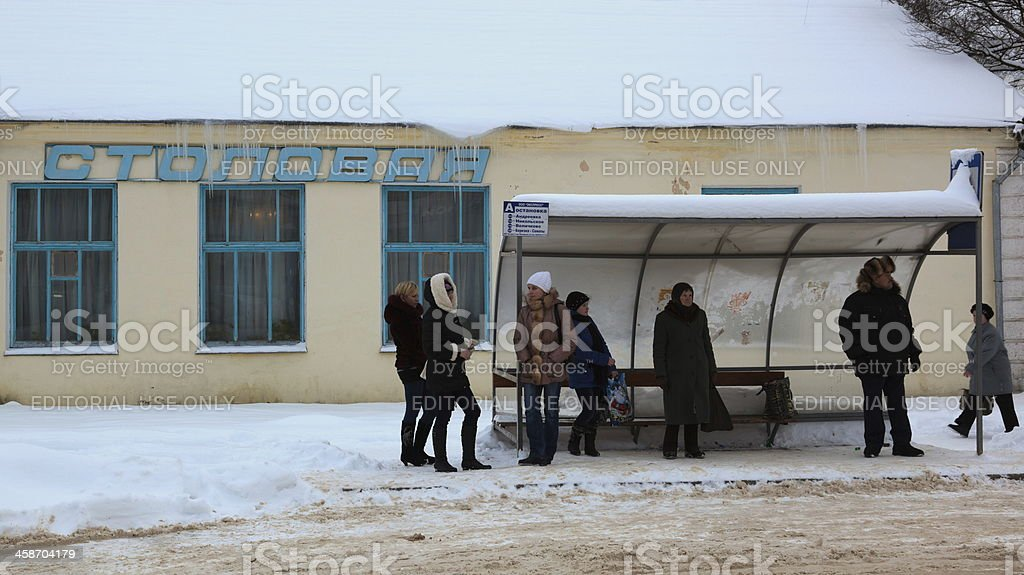People on a bus stop. Gagarin (former Gzhatsk). Russia. stock photo