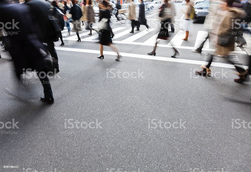 People on a crosswalk with a blur motion stock photo