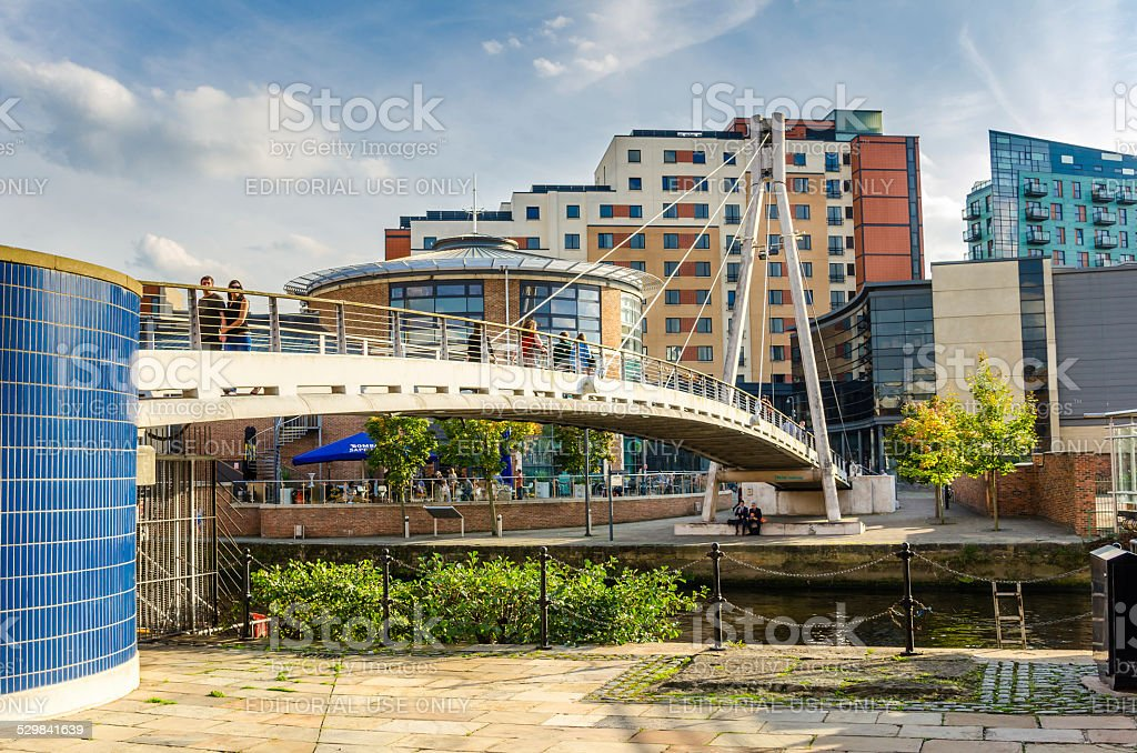 People on a Modern Footbridge in Leeds stock photo