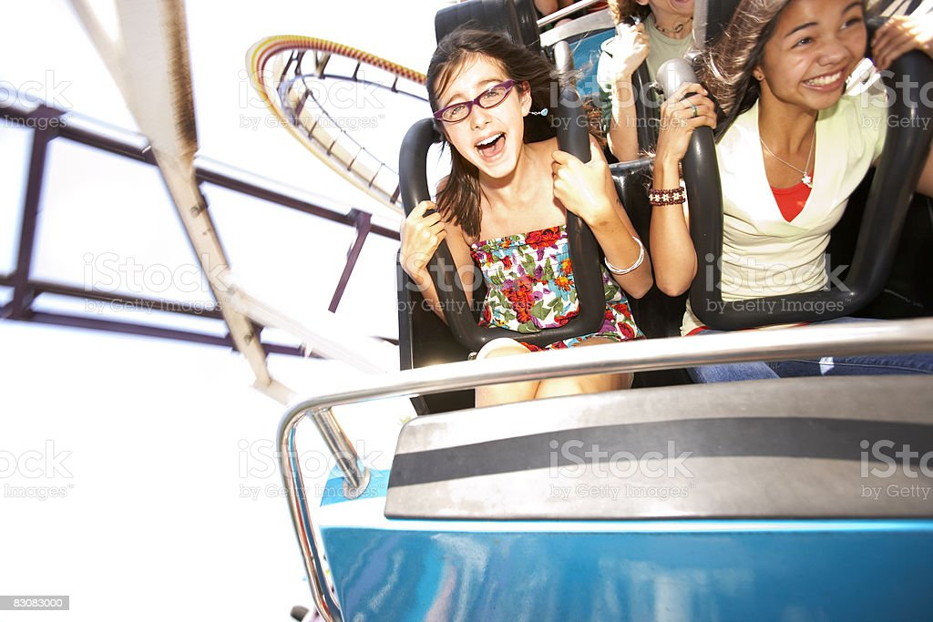 people on a roller coaster stock photo