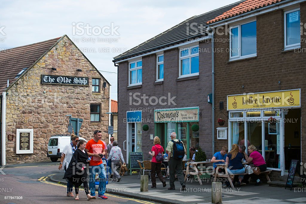 People on a street in the town of Seahouses stock photo