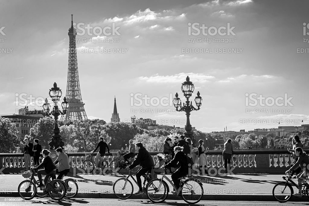 People on Alexandre III bridge in Paris stock photo