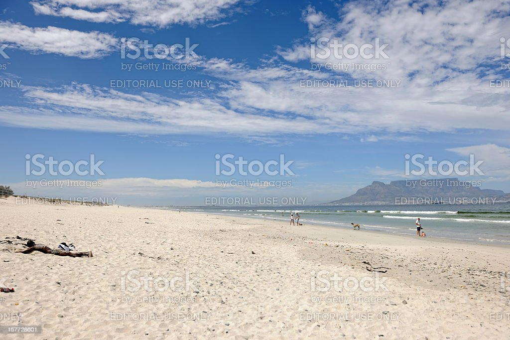 People on Bloubergstrand Beach Cape Town stock photo