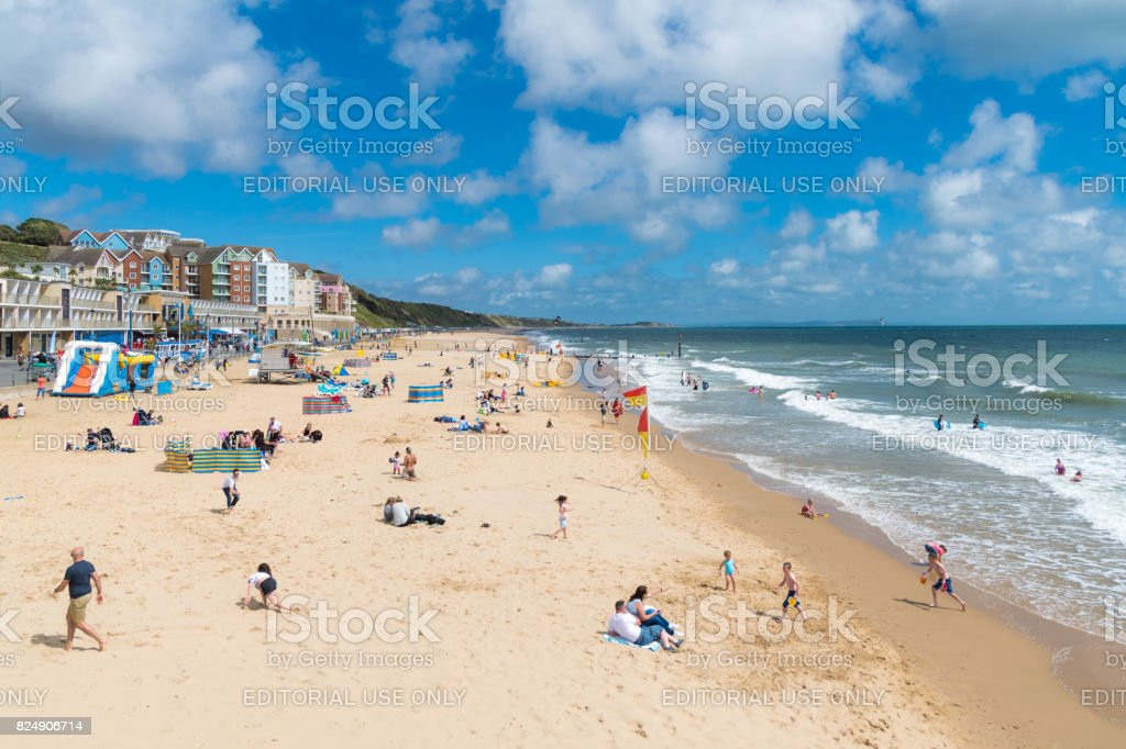 People on Boscombe Beach in Bournemouth on a summers day stock photo