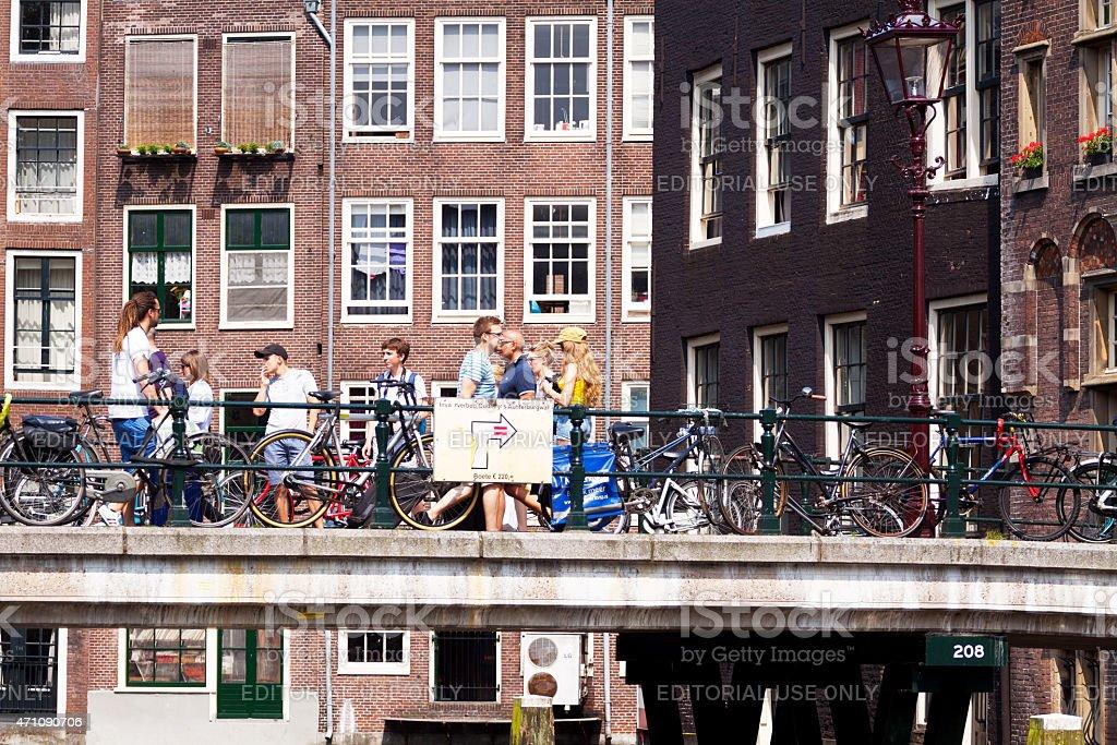 People on bridge over Voorburgswal stock photo