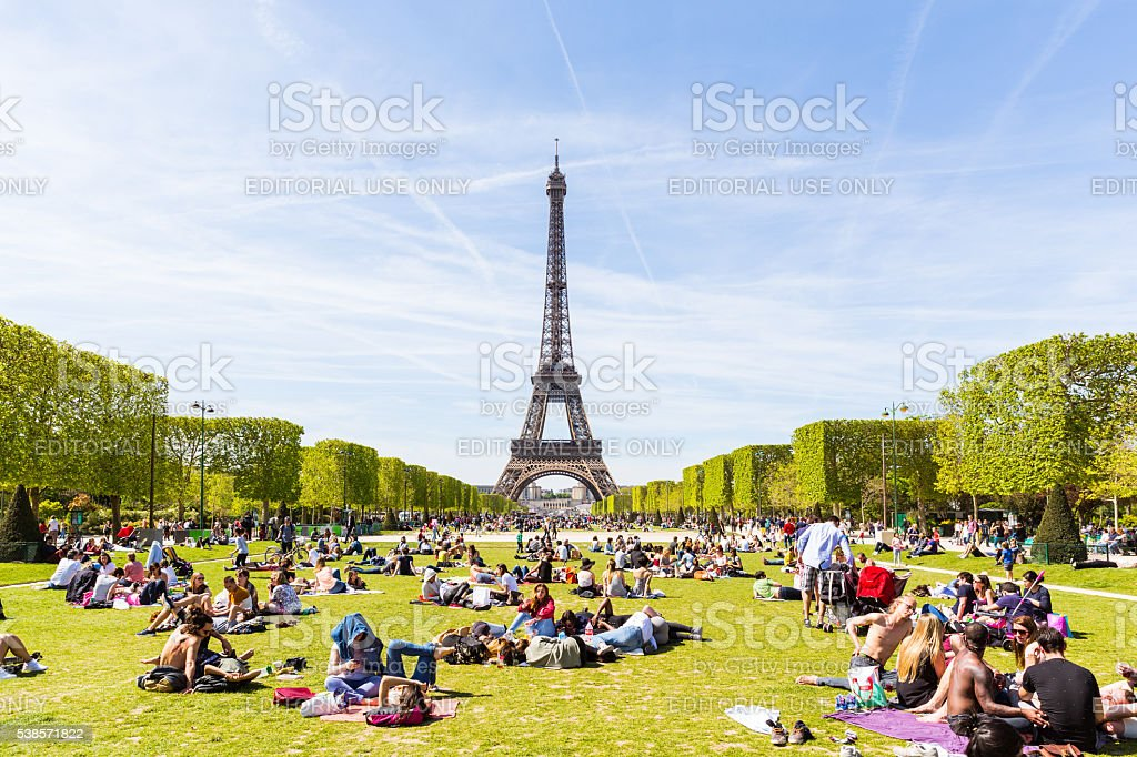 People on Champ de Mars with Eiffel Tower on background stock photo
