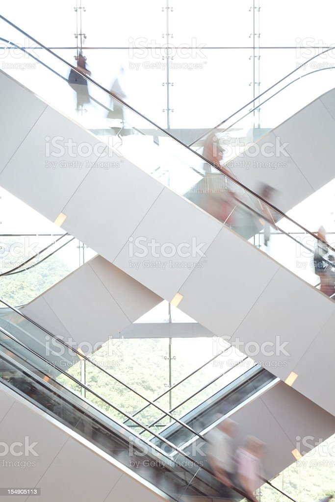 People on Escalator stock photo