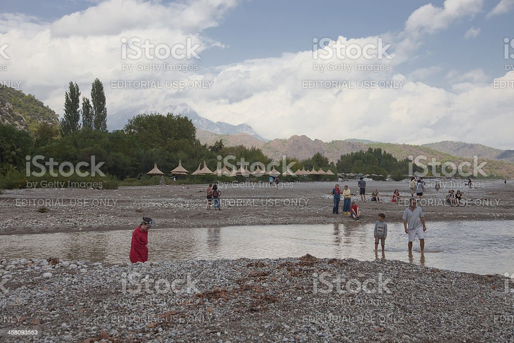 People on flooded beach at Turkish Riviera royalty-free stock photo
