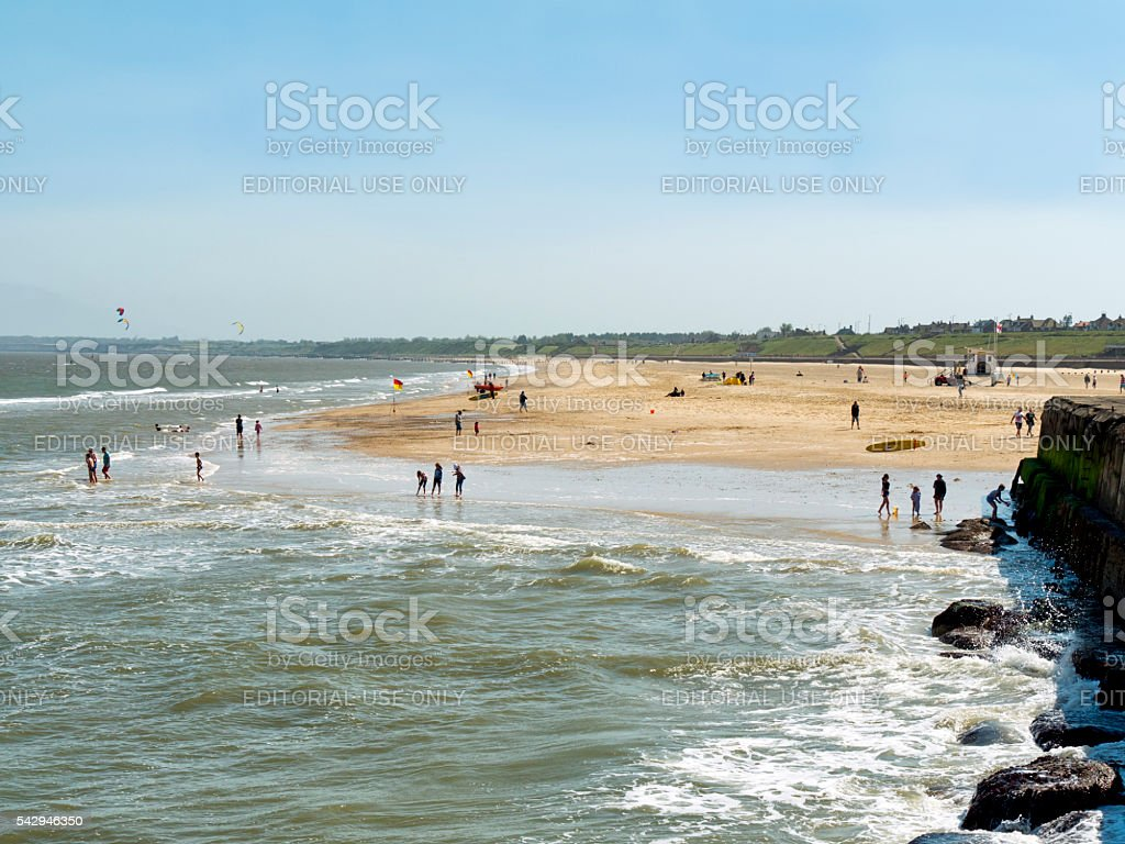 People on Gorleston-on-Sea beach stock photo