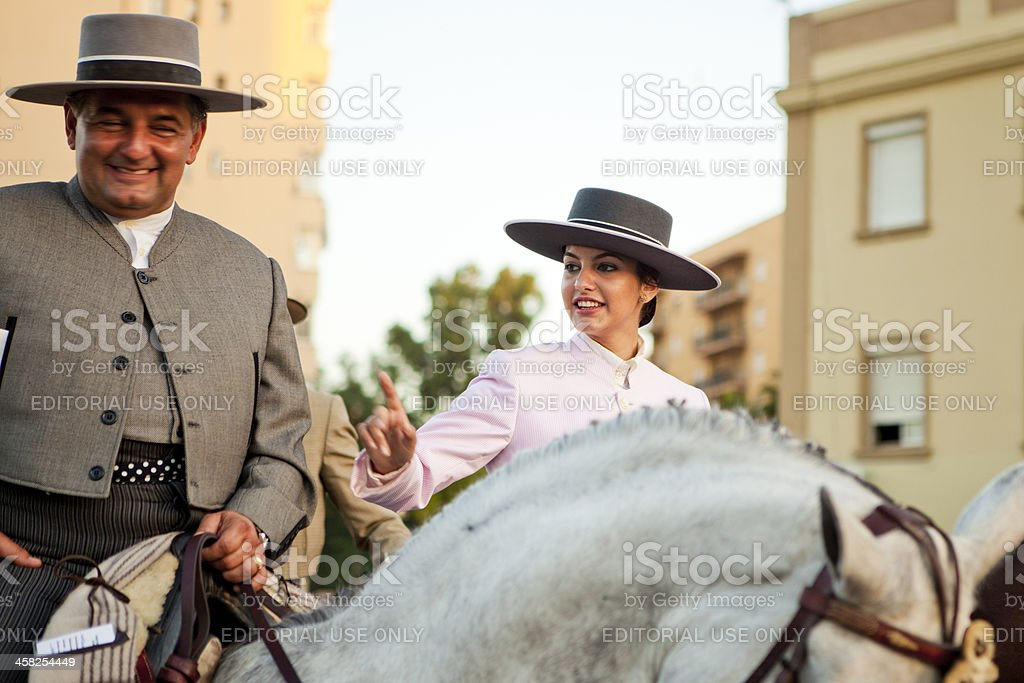 People on Horseback Marching in Andalusian Spring Parade royalty-free stock photo