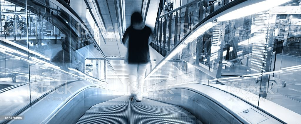People on moving stairs in shopping center royalty-free stock photo