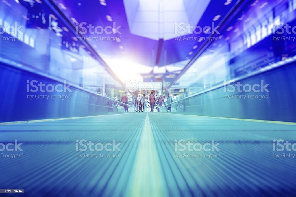 People on Moving Walkway at the Airport royalty-free stock photo