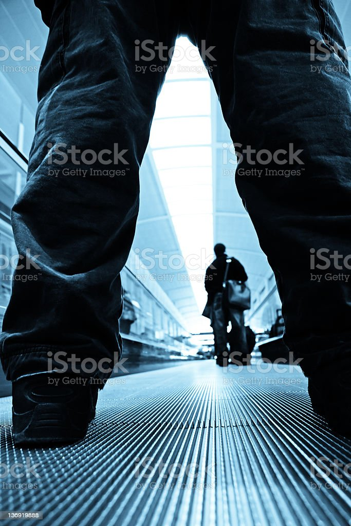 people on moving walkway royalty-free stock photo