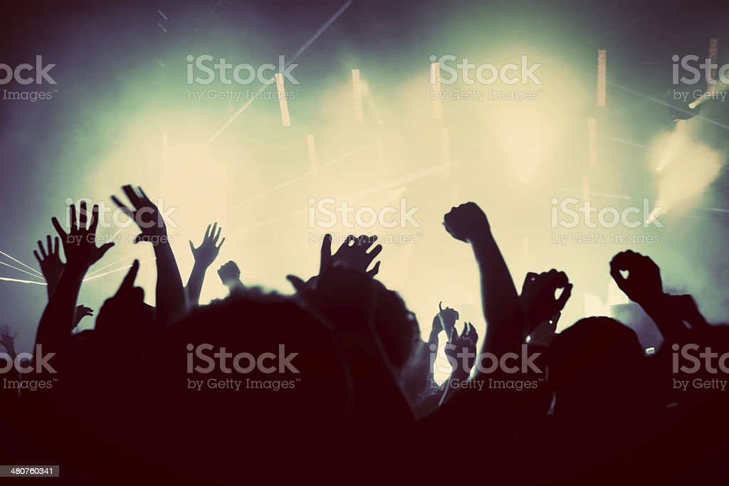People on music concert, disco party. Vintage stock photo